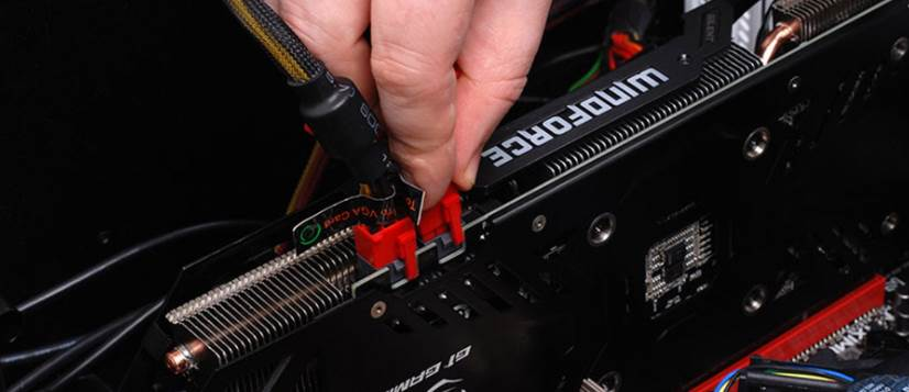 Image of a person connecting Power cables to gpu