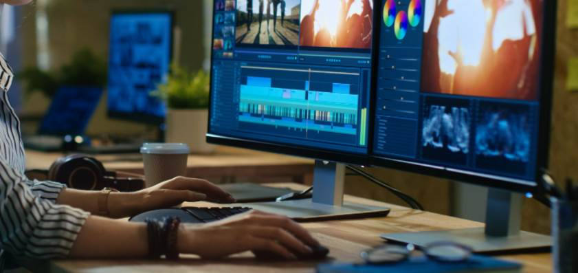 Image of two monitors running editing softwares